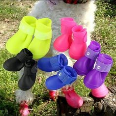 Waterproof and Reflective Dog Shoes | Perfect for medium and large dogs who suffer from allergies, these boots will ensure their paws stay dry in wet weather, but also have reflective Velcro for safe night time walking. They are ideal for protecting the pads of their paws from hot road surfaces or snow. #boots #shoes #welly #walking #dog #wonderfulwellie | www.tulsapetsmagazine.com