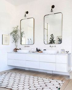 How to Create A Cohesive Look - The Effortless Chic - White floating bathroom vanity and neutral accents
