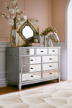 As glamorous as any star from Hollywood's Golden Era, yet as practical as we can make it, Pier 1's Hayworth Dresser is all about functional fashion. Handcrafted of durable hardwoods and covered with beveled mirrored surfaces, it gives you nine drawers' worth of generous storage space. You'll give it rave reviews.