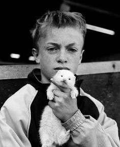 """boy with ferret"" by Chris Steele-Perkins"