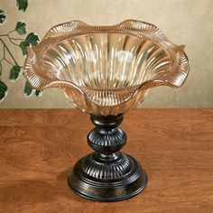 The Bettina Decorative Centerpiece Bowl is a regal addition to your tabletop display. Sophisticated accent has a honey-colored glass top that beautifully catches the light and a brown-finished, metal, pedestal-style base. Greenery Centerpiece, Table Centerpieces, Decorative Items, Decorative Bowls, Table Top Display, Stylish Home Decor, Tray Decor, Wow Products