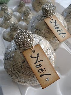 Vintage Christmas ornament, book pages + sparkle = beautiful and a realistic/gorgeous craft. might actually be worth the time investment/fun! Decorations Christmas, Diy Christmas Ornaments, Christmas Projects, Handmade Christmas, Paper Ornaments, Diy Decoupage Ornaments, Sheet Music Ornaments, Vintage Ornaments, Ball Ornaments