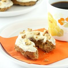 Carrot Cake Baked Doughnuts topped with cream cheese frosting and ready in 60 minutes.