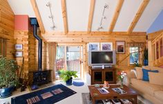 The great room features the kitchen and living space under a vaulted ceiling.