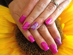 Acrylic nails with pink gel polish with glitter