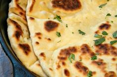 Pulling apart a toasty naan is like getting wrapped in a warm blanket then given a gentle loving squeeze. This delicious garlic butter naan recipe from a lovin' forkful is bear-hug-from-a-friend good. Grab a chunk and scoop up some Indian Lentil Dal.