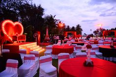 moulin rouge theme for sangeet; Beautiful centerpieces, special seating stage for couple