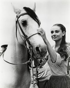 Audrey Hepburn with a beautiful horse (: