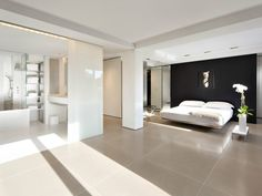 Contemporary Master Bedroom with Built-in bookshelf, Columns, Exposed beam, Concrete tile
