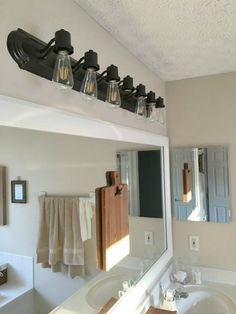 How To Update Bathroom Lighting It S As Easy As Changing A Lightbulb Your Funky Junk A