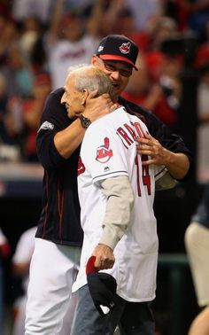 Cleveland Indians manager Terry Francona hugs his father Tito Francona after the latter threw out the first pitch in the ALDS  playoff game one between the Cleveland Indians and the Boston Red Sox played in Cleveland on Thursday, Oct. 6, 2016. Indians won game 1 of ALDS against the Red Sox  5-4 (Thomas Ondrey/The Plain Dealer)