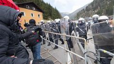 "Austria adopts tough measures to curb refugee influx This April 24, 2016 photo shows people gathering at the border station ""Brenner"" between Austria and Italy to protest against planned border con…"