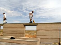 earth architecture | Hank Louis and architecture graduate student work on rammed earth home ...