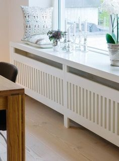 Use these radiator cover ideas to transform your room. See how to use a radiator cover for storage, reading nooks under windows, corner cabinets + more. Home Radiators, Radiator Cover, Radiator Shelf, Home Living Room, Apartment Living, Home Projects, Room Inspiration, House Design, Interior Design