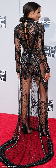 Sheer delight: Singer Ciara wore a long-sleeved, black beaded gown with high neckline