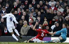 Jermaine Beckford slides the ball beyond Tomasz Kuszczcak as Leeds win at Old Trafford in the FA Cup in 2010.