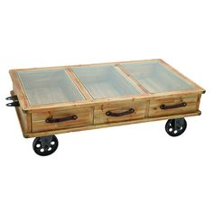 Portable, Weathered Wooden Coffee Table - with a frosted glass top and inspired by the classic European kitchen cart style.  This would be amazing in the right right decor.