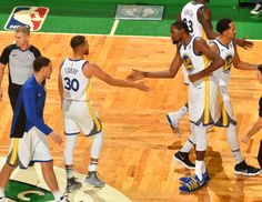 Kevin Durant and Stephen Curry of the Golden State Warriors shake hands during the game against the Boston Celtics on November 16 2017 at the TD...