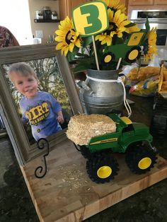 {food table centerpiece} • John Deere birthday • John Deere theme party • kids birthday • boy birthday party ideas • green and yellow party colors • tractor birthday • John Deere •