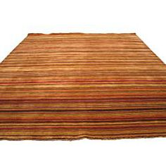 @Overstock - Handmade Lori Toni Wool Rug (8' x 10') - Add casual style to your home decor with dense and high-quality handmade rugFloor rug is handmade of luxurious, soft, plush, New Zealand wool pileStripes in red, green, blue, purple, gold and beige alternate in area rug  http://www.overstock.com/Home-Garden/Handmade-Lori-Toni-Wool-Rug-8-x-10/4488104/product.html?CID=214117 $539.74
