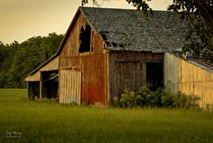 Bloomington-Normal was first built on the rich farmland of McLean County and you don't have to go far out of town to see farm scenes. This photo was taken just north of Normal, Illinois on Linden Street Road. ~ Rundown Barn at Sunset by TroyMarcyPhotography.com, via Flickr