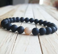 Details: 8mm black Onyx, sunstone To see more 7 chakra bracelets: https://www.etsy.com/shop/OrientAppeal?ref=hdr_shop_menu§ion_id=19115934 Please click in the following link to see more gemstone bracelets: https://www.etsy.com/shop/OrientAppeal?ref=hdr_shop_menu Pick you size