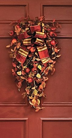 Our Brush Mountain Wreath brims with lifelike mountain ash leaves, black currant and pomegranate to create a spectacle of seasonal elements that honors the fall harvest.