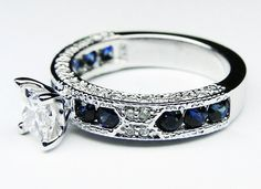 diamond and saphire ring by Sandra Turner. This would be beautiful also with a light blue saphire as the center piece with the darker blue saphires where they are now.