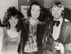 "(l-r) Karen Carpenter, Herb Alpert, and Richard Carpenter  Undated    A signed the Carpenters in 1969, and shortly thereafter Alpert gave them the sheet music for the Burt Bacharach-Hal David song ""Close to You."" That song became their first gold single in 1970 and won a Grammy Award for best contemporary vocal performance by a duo, group, or chorus."