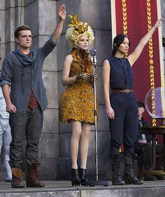 Peeta, Effie Trinket and Katniss in 'The Hunger Games: Catching Fire' (2013). Costume Designer: Trish Summerville