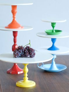 Cake Pedestals - Fun DIY idea: old candlesticks, high-gloss spray paint, and simple white plates for the tops.