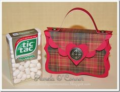 Here is the tutorial I promised yesterday for my version of the Tic Tac Valentine Purse. I made some alterations from the one I posted on Sa...
