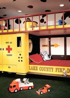 Firefighter Themed Childrenu0027s Room. This Yellow Fire Truck Houses Not Only  A Bed On