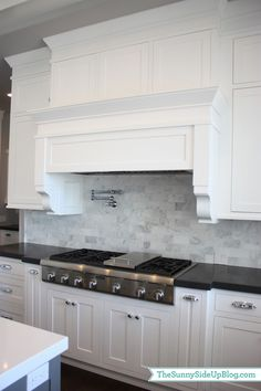 The grey tiles, white units & black work tops.The Sunny Side Up Blog