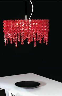 Red glass crystals - quite unusual, but very glam! ThePreziosa oval glass crystal ceiling light from Marchetti:  http://www.italian-lighting-centre.co.uk/modern/preziosa-oval-glass-crystal-ceiling-light-from-marchetti-p-6034.html