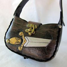 The Dagger....Small Handmade Tooled Leather Purse Made to order. $120.00, via Etsy. (I'd get it as a crossbody bag)