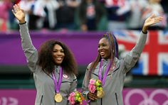 Gold medalists Serena Williams of the United States and Venus Williams of the United States celebrate on the popdium during the medal ceremony for the Women's Doubles Tennis on Day 9 of the London 2012 Olympic Games at the All England Lawn Tennis and Croquet Club on August 5, 2012 in London, England.