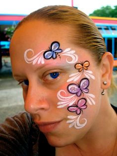 different colored butterflies and oh yes your seeing that right i actually used glitter on myself i hate glitter lol
