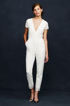 Lace jumpsuit by J. Crew with sheer sleeves and bow detailing on the back.
