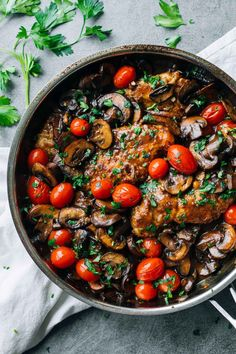A simple Chicken Marsala recipe featuring fresh tomatoes, pan-fried chicken breasts, sauteed mushrooms, and a Marsala wine sauce.