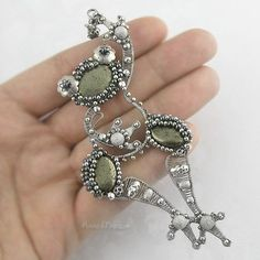 This hand crafted FROG pendant, made from fine silver, sterling silver, Pyrite and Hematite, is fab! The wire work is lovely and the froggy has so much personality!