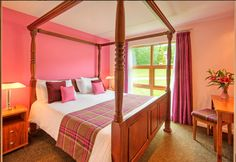 Romantic lodge in Loch Lomond with four poster bed and pink furnishings. Part of our 5 star luxury holiday homes in Balmaha, Scotland situated by the shores of Loch Lomond.