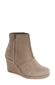Free shipping and returns on TOMS 'Desert' Wedge Bootie (Women) at Nordstrom.com. A croc-embossed leather panel adds exotic edge to a soft suedebootie set on a sleek wrapped wedge, for a versatile style that toes the line between casual and sophisticated.