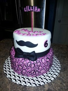 Pink and purple mustache cake in fondant! Girls birthday cake by TC Cakes in Houston!
