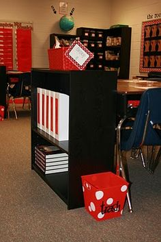I LOVE this. Each group of desks has their own bookshelf, trash can, materials, etc.  It'd be great to have that many bookcases and a room large enough to set that up.