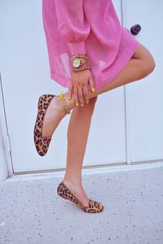 I love everything about this.  Gold watch w/multiple braceletts, purple leopard flats, hot pink dress and yellow nails.