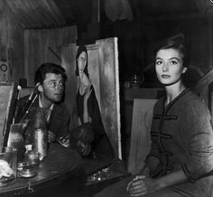 """Gérard Philippe and Anouk Aimée on the set of """"Montparnasse 19"""" directed by…"""