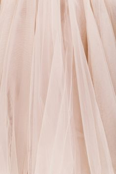 I just ordered a nude pink tulle skirt to wear to my sister's wedding! My first tutu, finally! I am going to wear it with nude pumps and clutch and a white lace top. I'm so excited!