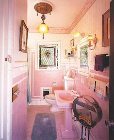 """Article: """"The Dilemma of a Pink Bathroom"""" by Jane Powell, Friday October 19, 2007. If you're stuck with a pink bathroom, here are a few suggestions for dealing with it that don't involve ripping the entire thing out."""