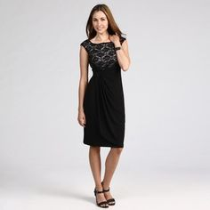 Exude elegance and style in this Connected Apparel lace dress. Classic black lace over an ivory bodice makes it suitable for the office or an evening out on the town. Cap sleeves, a ruched waist, and scoop neck complete the look.http://www.overstock.com/Clothing-Shoes/Connected-Apparel-Womens-Black-Ivory-Lace-Dress/6322814/product.html?CID=214117 $44.99